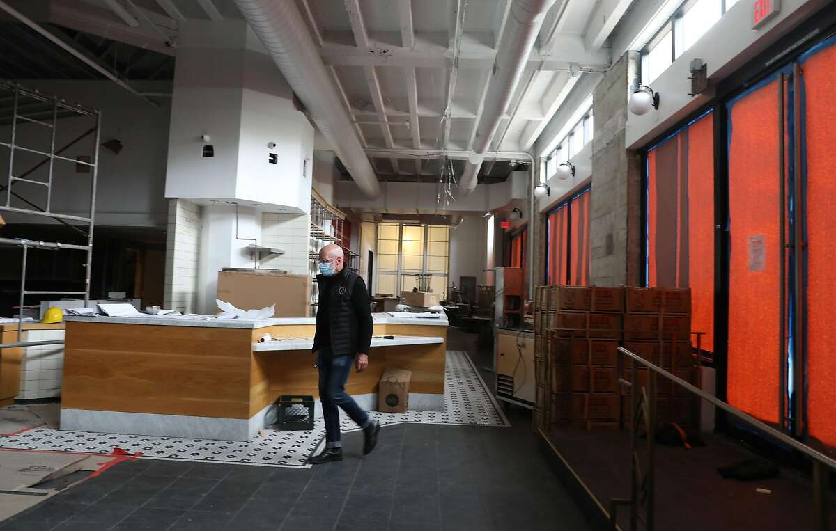 Owner Chris Foley walks through the upcoming food hall where eight food concepts including Mensho seen on Tuesday, July 28, 2020, in San Francisco, Calif.