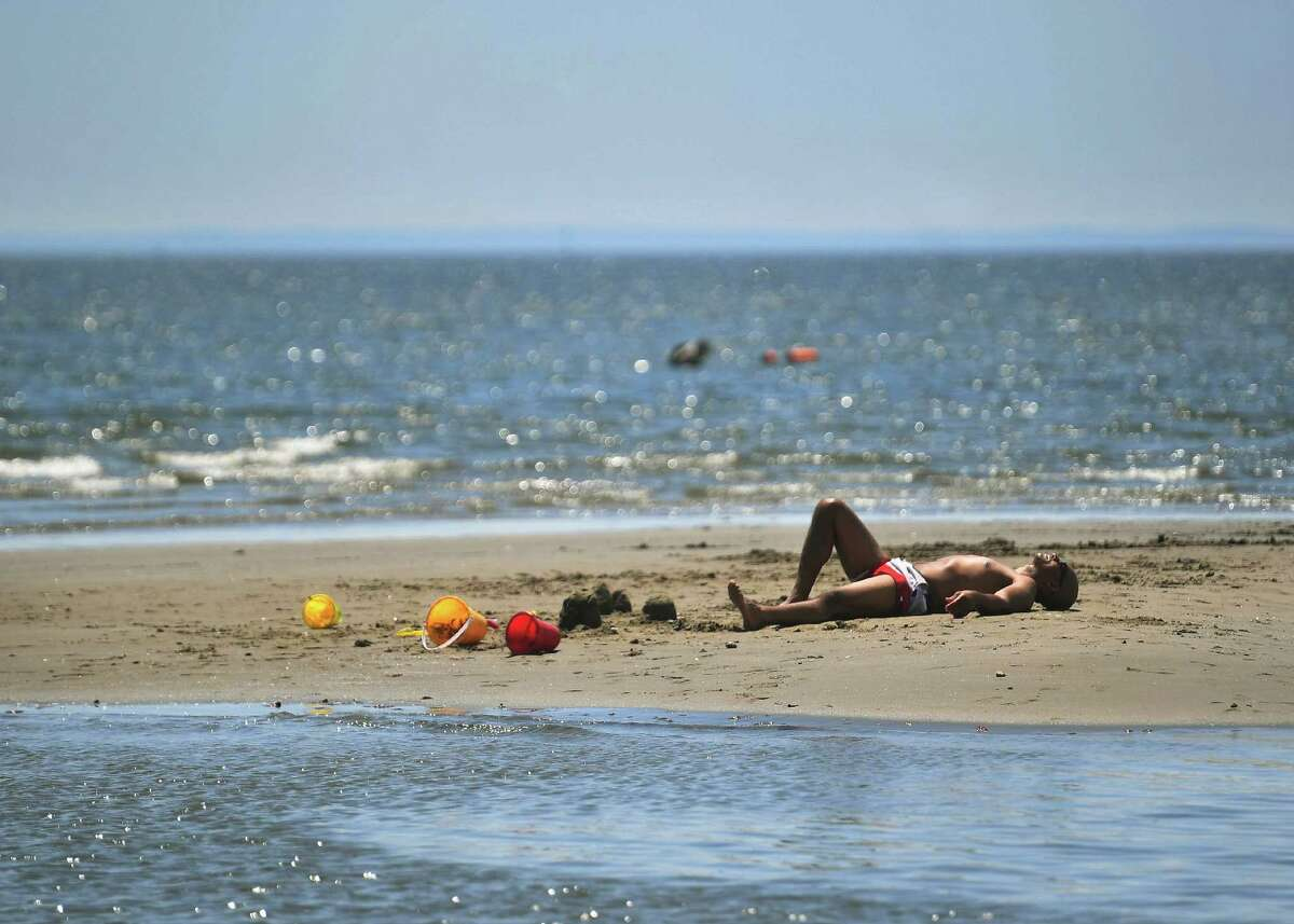 People beat the heat at Seaside Park in Bridgeport, Conn. on Tuesday, July 28, 2020. A recent Yale University report examined how Connecticut residents' health can be affected as temperatures rise.