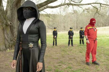 """This image released by HBO shows Regina King in a scene from """"Watchmen."""" The series was nominated for an Emmy Award for outstanding limited series on Tuesday, July 28, 2020. King was also nominated for outstanding lead actress in a limited series or movie. (Mark Hill/HBO via AP)"""