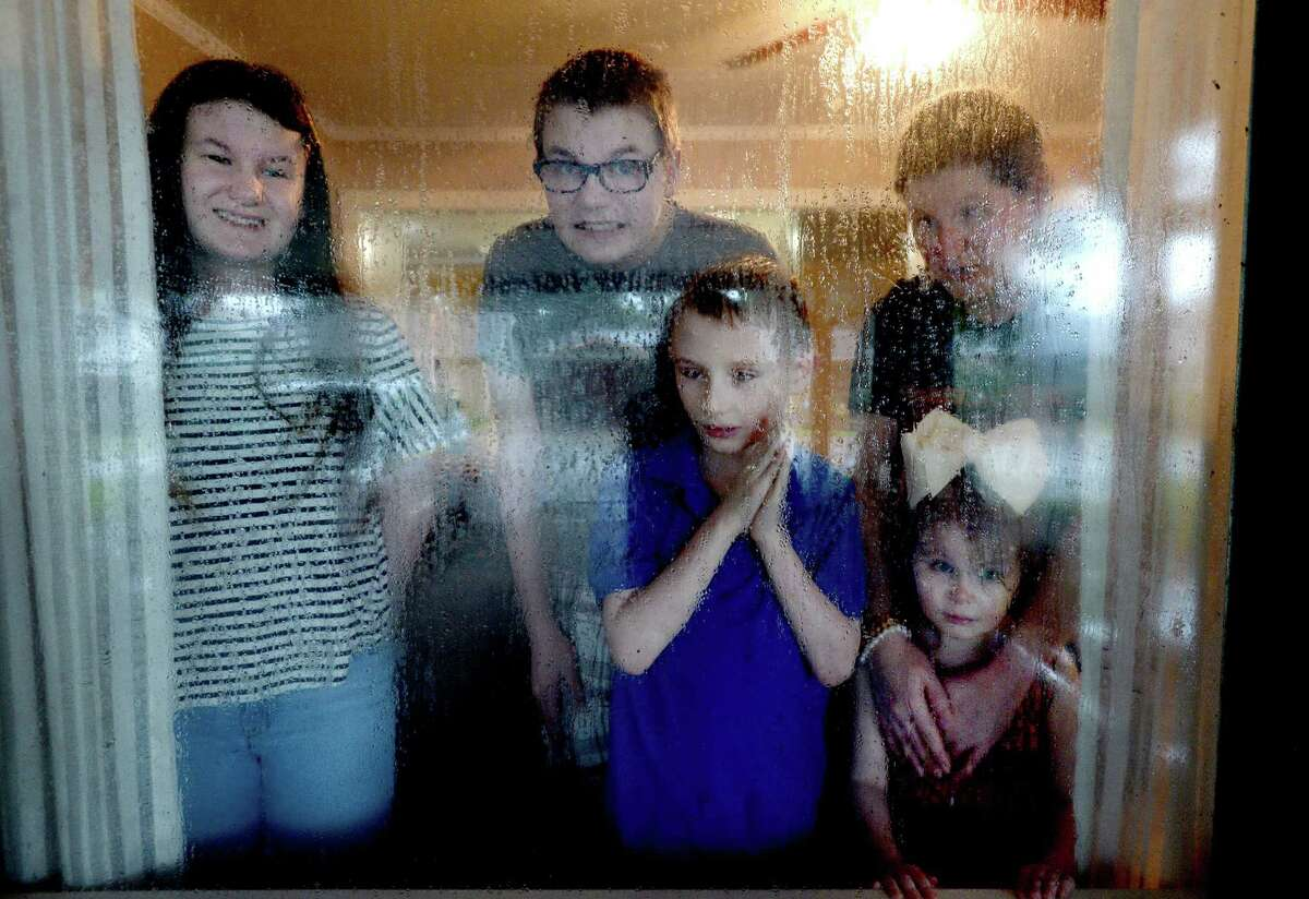 Christy Attaway says her children - Jace, 19, Emily, 15, Benjamin, 10, Olivia, 7, and Penelope, 4 - will be doing homebound learning due to health concerns. She is among the Port Neches - Groves families that are grappling with the district's decision not to offer distance learning as an option amid the ongoing pandemic. Photo taken Tuesday, July 28, 2020 Kim Brent/The Enterprise