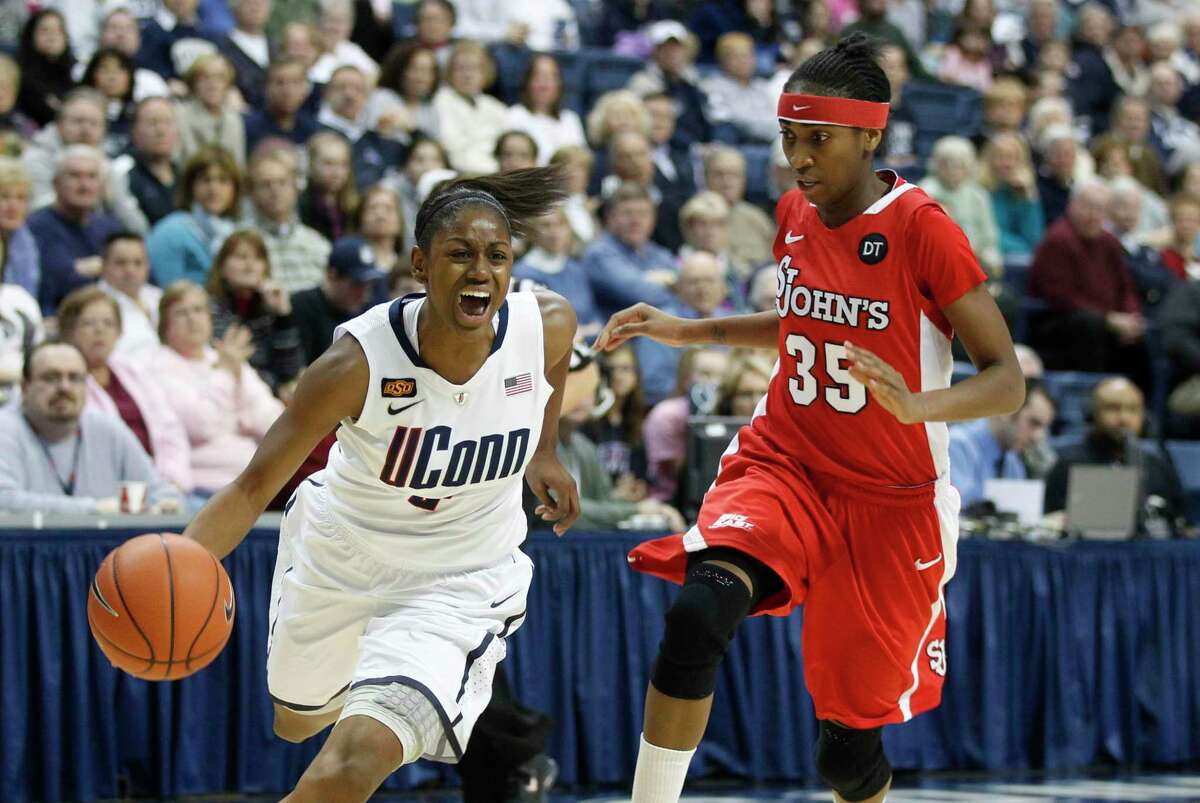 Feb 18, 2012; Storrs, CT, USA; Connecticut Huskies guard Tiffany Hayes (left) drives the ball in the first half against St. John's Red Storm guard Shenneika Smith (35) at Gampel Pavilion. Mandatory Credit: David Butler II-US PRESSWIRE