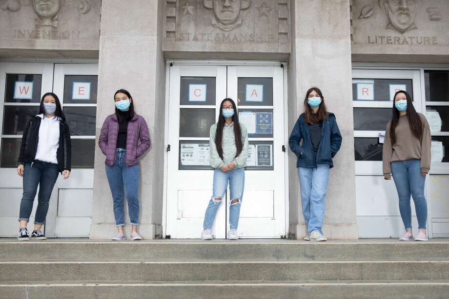 George Washington High School students (left to right) Lana Nguyen, Susanna Lau, Nancy Deng, Sophia Hernandez, and Serena Wong created SupplyHopeInfo. Their organization collects donations to purchase school materials for low-income students who need help with remote learning. Photographed outside George Washington High School on July 28, 2020. Photo: Douglas Zimmerman/SFGATE / SFGATE