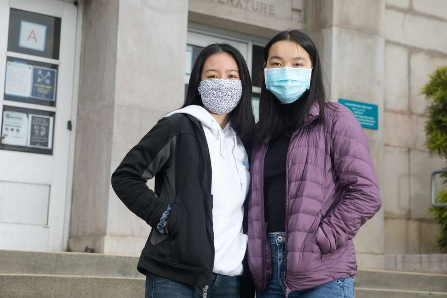 George Washington High School students (left to right) Lana Nguyen and Susanna Lau created SupplyHopeInfo. Their organization collects donations to purchase school materials for low-income students who need help with remote learning. Photographed outside George Washington High School on July 28, 2020. Photo: Douglas Zimmerman/SFGATE / SFGATE