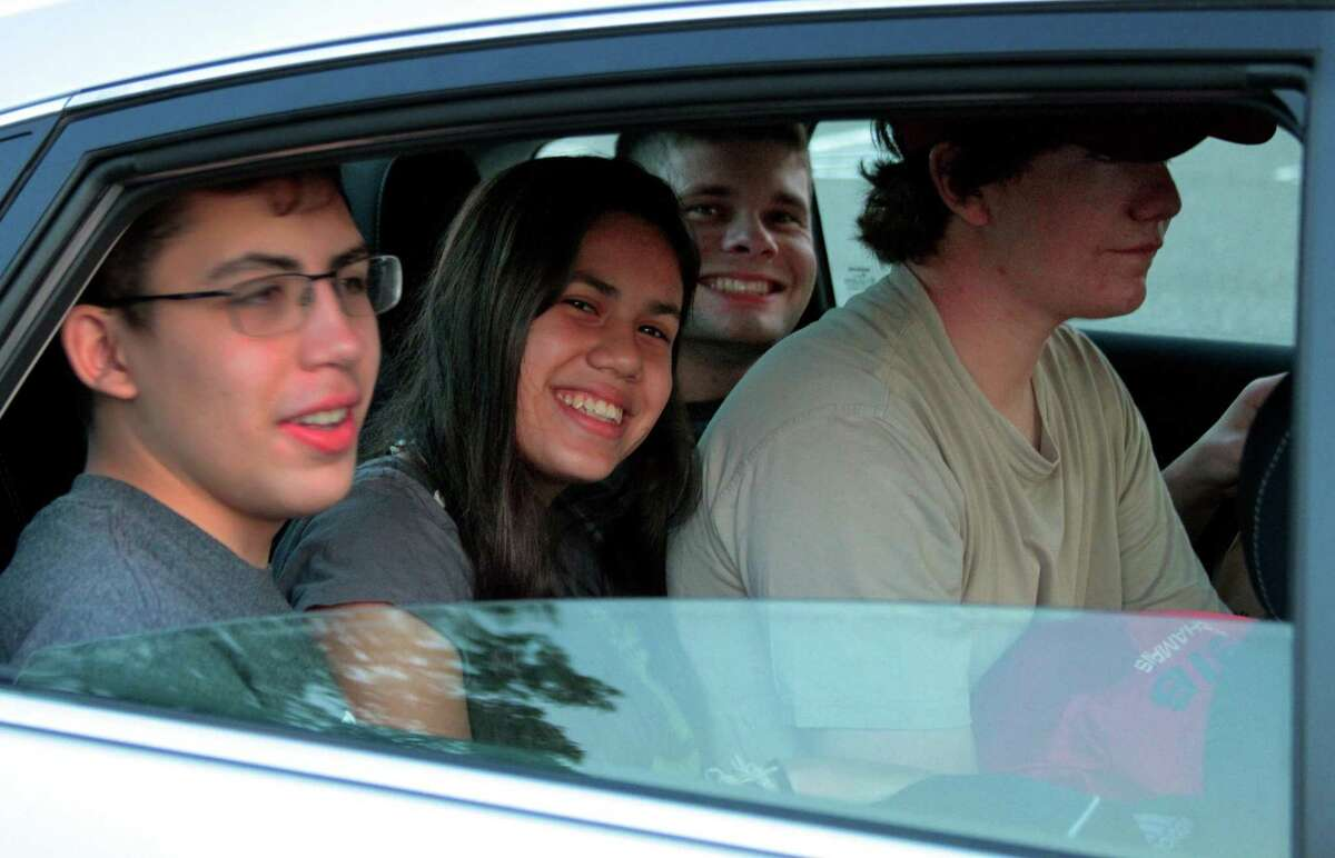 Trumbull High School student Emily Umana, in center, arrives with her friends for THS Thespian Society's Summer Drive-In Movie Series in the parking lot at Trumbull High School in Trumbull, Conn., on Saturday July 25, 2020. The next movie, The Lion King, is slated for Saturday Aug. 1st at 7:30 p.m.