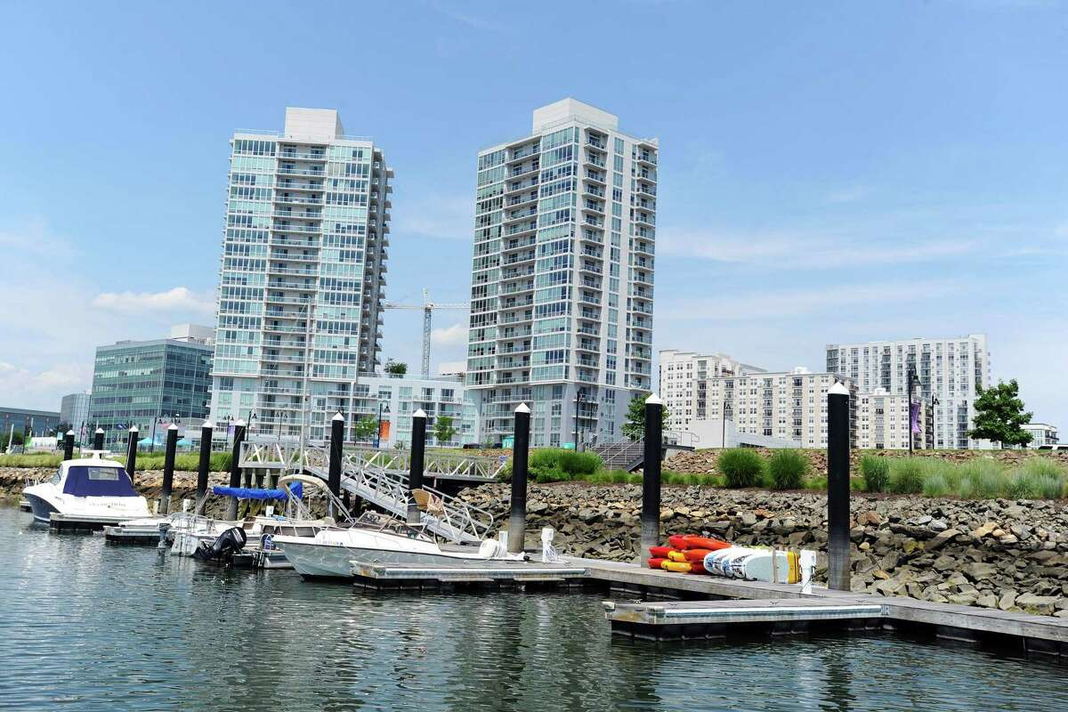 Stamford boater Randy Dinter, and wife Harriet, boat around Stamford Harbor pointing to various locations such as the 14-acre peninsula that used to house the Brewer's Yacht Haven West boatyard and now is owned by BLT on Tuesday, July 12, 2016.