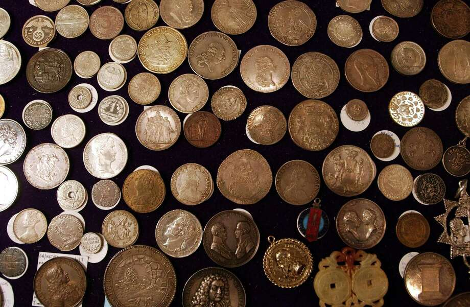 Coins don't work well as investments, but they are OK as collectibles, according to columnist Michael Taylor. Photo: Spencer Platt /Getty Images / Getty Images North America