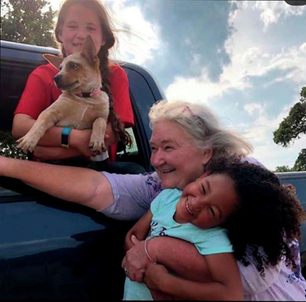 Cathy Peeler, who died Monday from COVID-19, sharing a fun moment with two of her granddaughters, Nora (left) and Serenity.