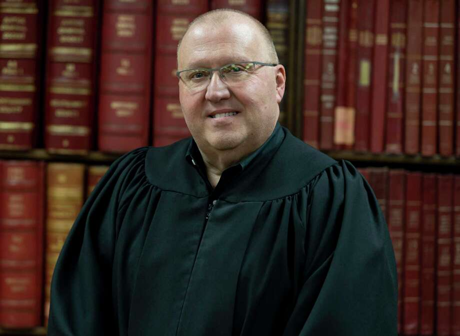 Judge Wayne Mack, Precinct 1 Justice of the Peace, poses for a portrait in his chambers at the Montgomery County West Annex, Thursday, July 23, 2020. Judge Mack recently received an award for justice of the peace from the Justices of the Peace and Constable's Association of Texas. Photo: Gustavo Huerta, Houston Chronicle / Staff Photographer / Houston Chronicle © 2020