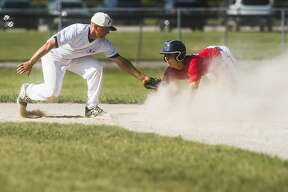 Gladwin Thunder's Reed Raymond looks up after sliding into second base during a game against Michigan Tribe Tuesday, July 28, 2020 at Wickes Park in Saginaw. (Katy Kildee/kkildee@mdn.net)