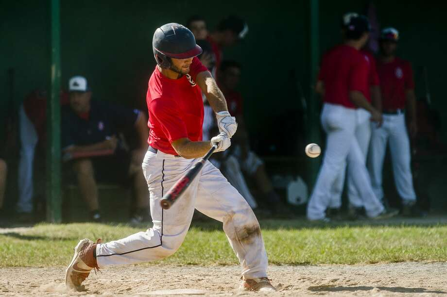 Gladwin Thunder's Hunter Merillat swings on a pitch during a game against Michigan Tribe Tuesday, July 28, 2020 at Wickes Park in Saginaw. (Katy Kildee/kkildee@mdn.net) Photo: (Katy Kildee/kkildee@mdn.net)