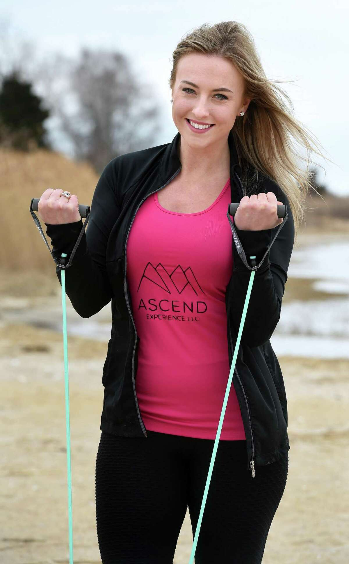 Former New England Patriot cheerleader and owner of Ascend Experience, Alex Brandy, is photographed at the Clinton Town Beach on March 12, 2020. Workouts are planned for Monday, Wednesday, Friday at 8:30 a.m., and Zaccagnini said she loves the time spent with Brandy.
