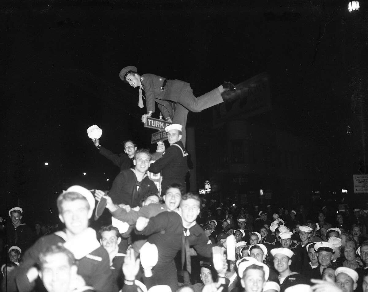 V-J Day celebration in San Francisco ..August 14-15 1945 End of World War II, Japan surrenders Negatives says August 13, 1945, Market Street Eve of V-J Day