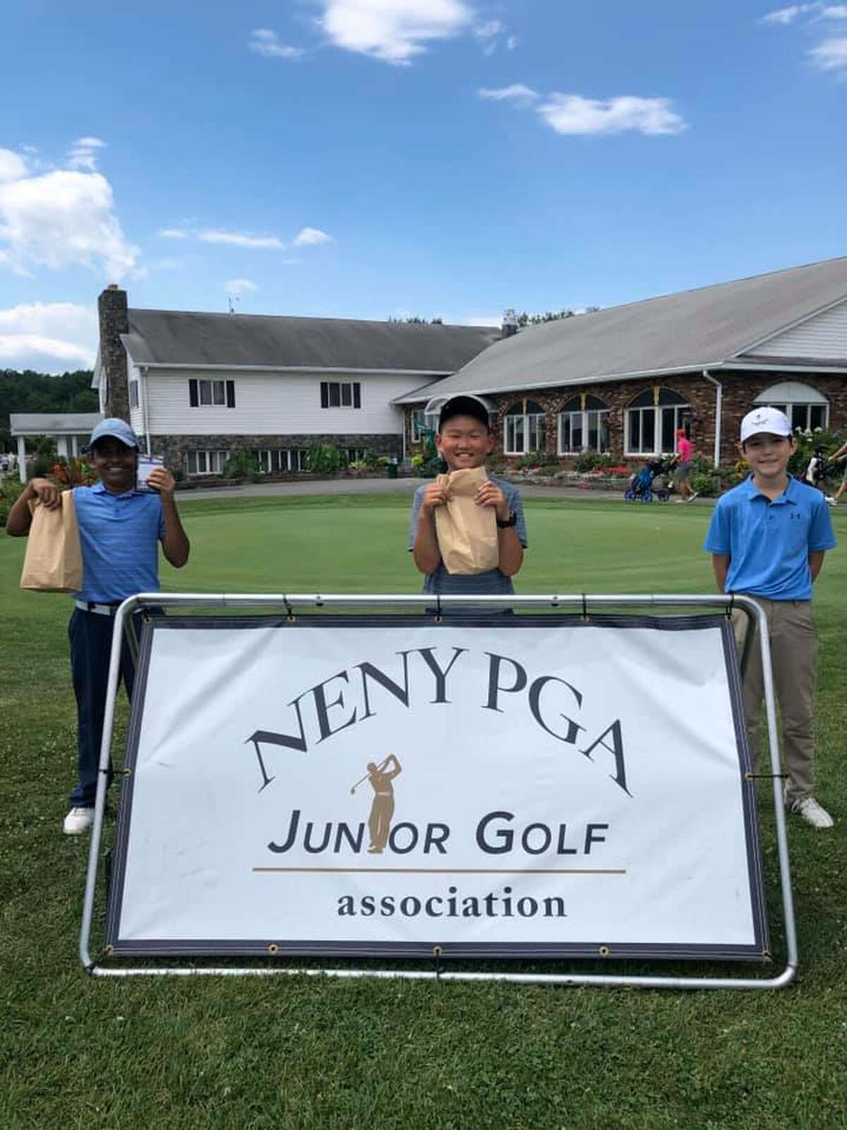 Boys left to Right (Nicky Jadav, age 11, Latham); Joel Wong (age 10, Clifton Park), Adam Judson (age 11, Loudonville, NY) at the NENYPGA Junior Golf tournament.