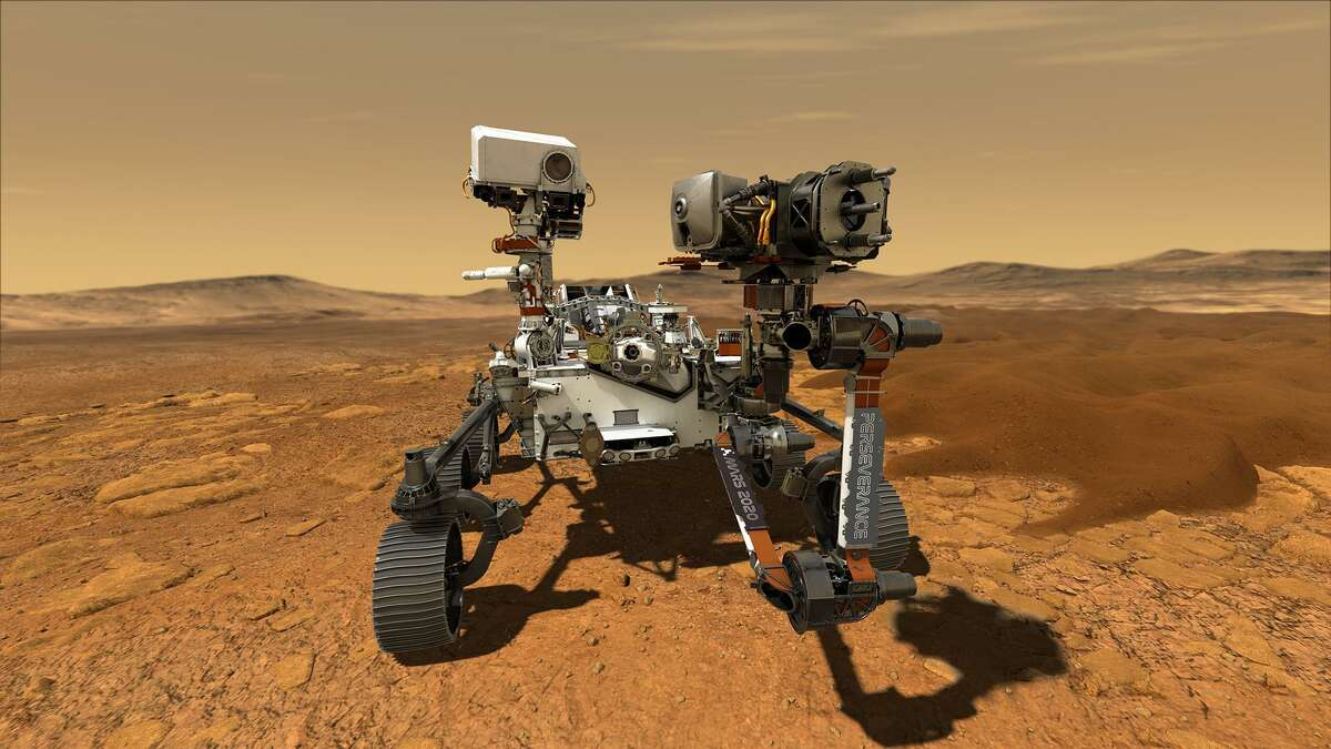 This illustration depicts NASA's Perseverance rover operating on the surface of Mars. Perseverance is expected to land at the Red Planet's Jezero Crater on Feb. 18, 2021.