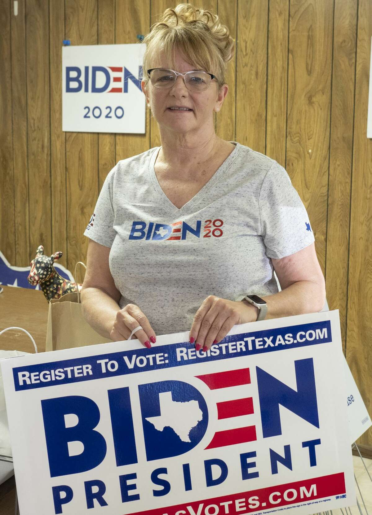 Cathy Broadrick, Midland Democratic Party Chair, shows off the new Biden for President yard signs they just received 07/28/2020 evening before a parade through Midland. Tim Fischer/Reporter-Telegram