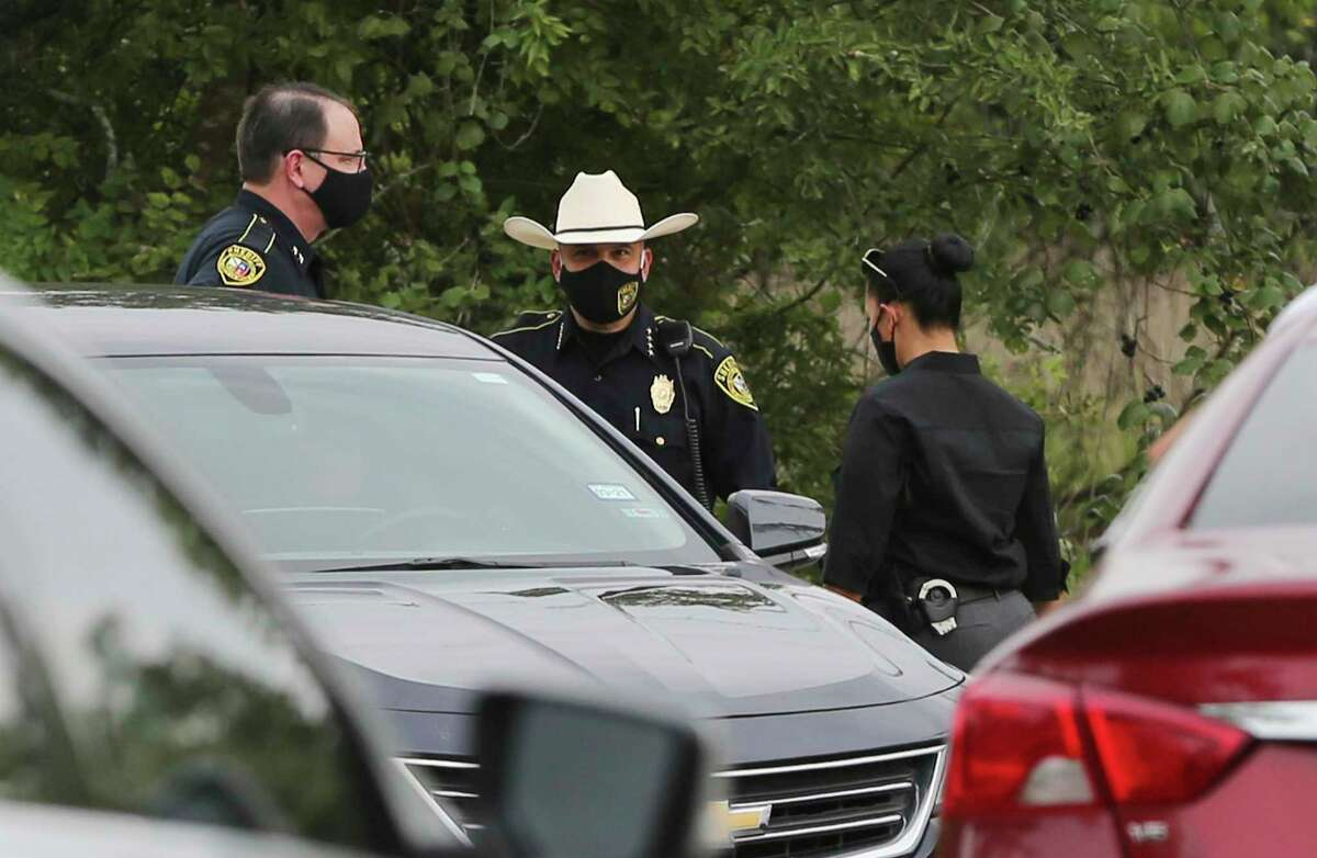 Bexar County Sheriff Javier Salazar (center) and members of his department investigate the appearance of a body near the intersection of Spanish Grant and LaSoya in far south Bexar County on Tuesday, July 28, 2020.