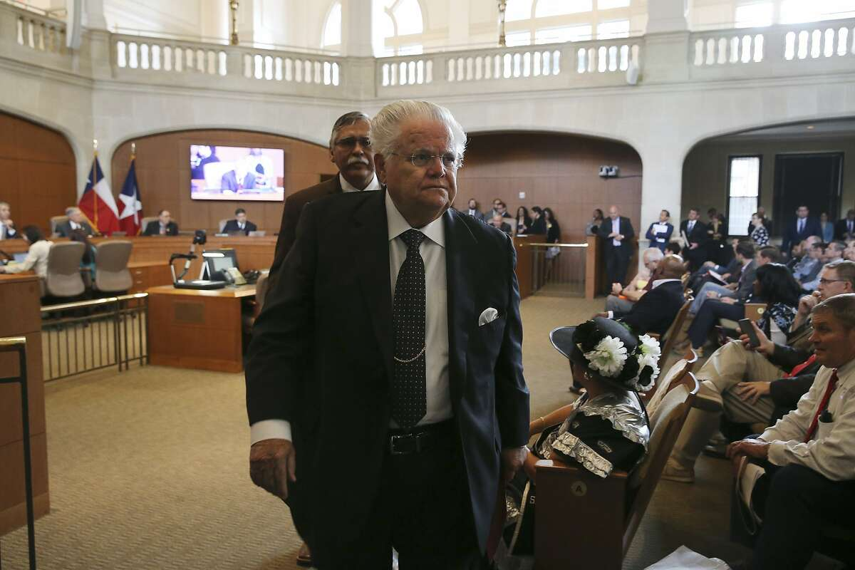 Cornerstone Church Pastor John Hagee leaves the San Antonio City Council Chambers in 2019.