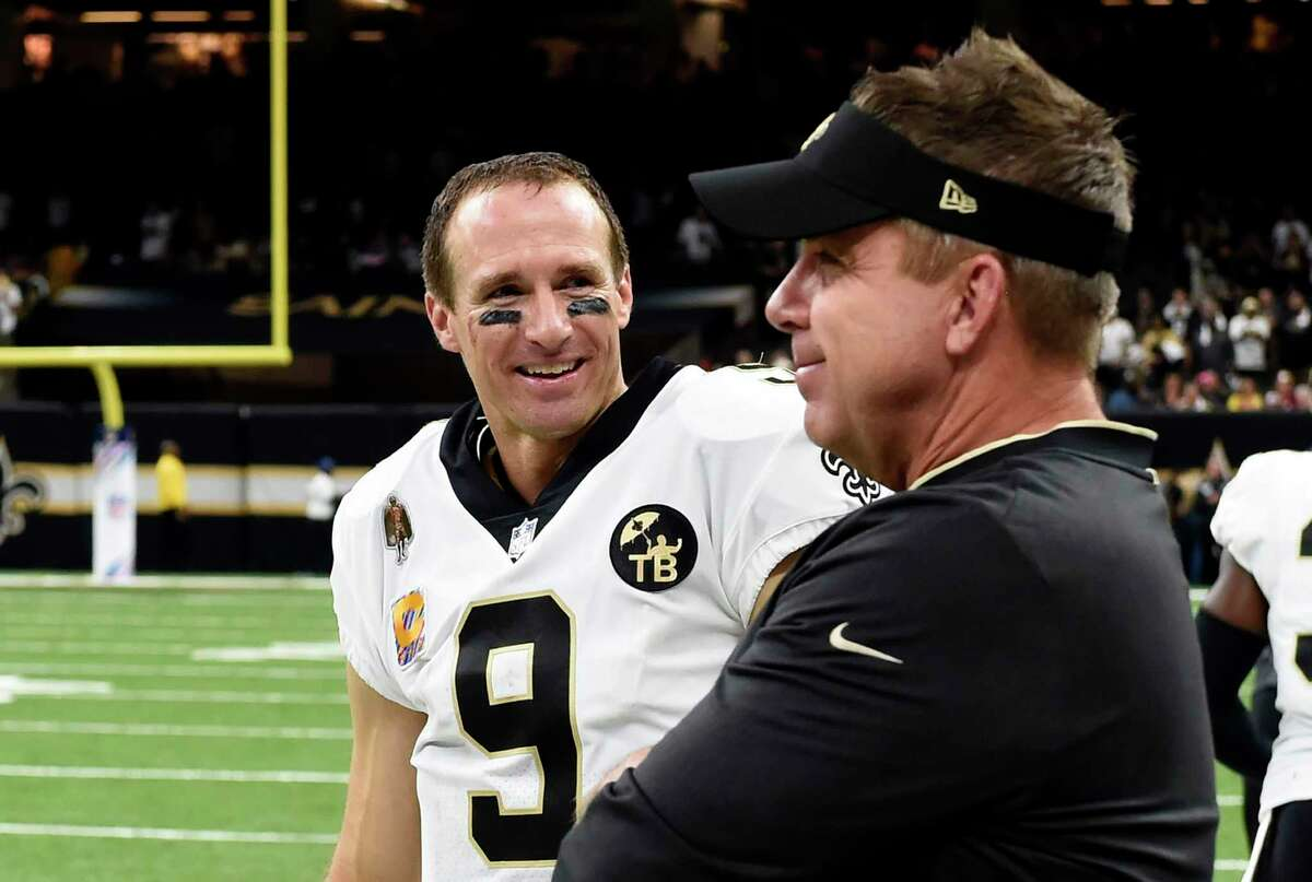 FILE - In this Oct. 8, 2018, file photo, New Orleans Saints quarterback Drew Brees (9) smiles with head coach Sean Payton after being taken out in the second half of an NFL football game against the Washington Redskins in New Orleans. Saints coach Sean Payton said he didn't mean to insinuate on a television appearance this week that record-setting quarterback Drew Brees had informed him of plans to retire after the upcoming season. a€œI'm a big dummy,a€ Payton said Wednesday, April 1, 2020, during a conference call with media in New Orleans. a€œI honestly don't know if ita€™s his last year. I think the thing he's done, and we've all done, is taking it year by year.a€ (AP Photo/Bill Feig, File)