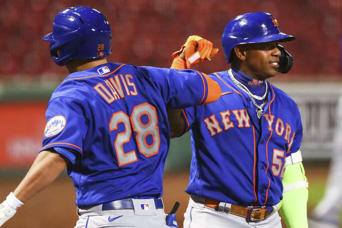 BOSTON, MA - JULY 28: J.D. Davis #28 and Yoenis Cespedes #52 of the New York Mets after Davis' two-run home run in the fifth inning against the Boston Red Sox at Fenway Park on July 28, 2020 in Boston, Massachusetts. (Photo by Adam Glanzman/Getty Images)