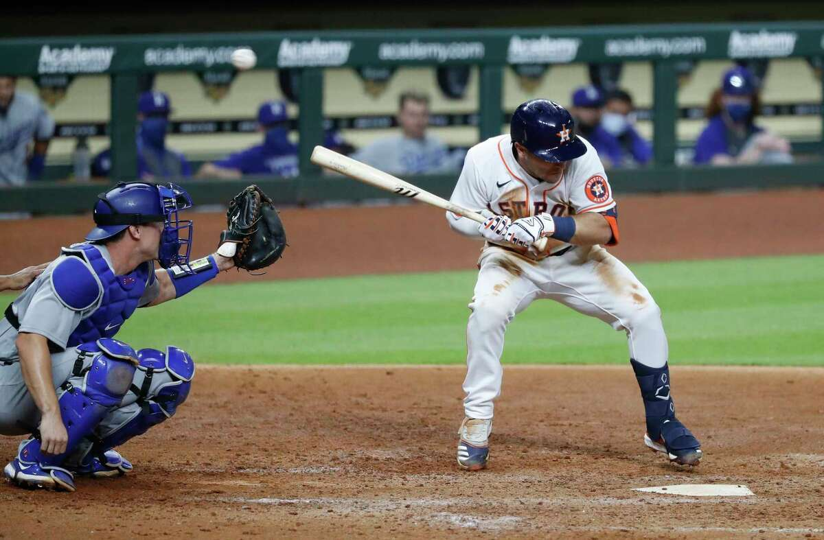 Houston Astros Alex Bregman ducks as Los Angeles Dodgers relief pitcher Joe Kelly threw behind him during the sixth inning of an MLB baseball game at Minute Maid Park, Tuesday, July 28, 2020, in Houston.