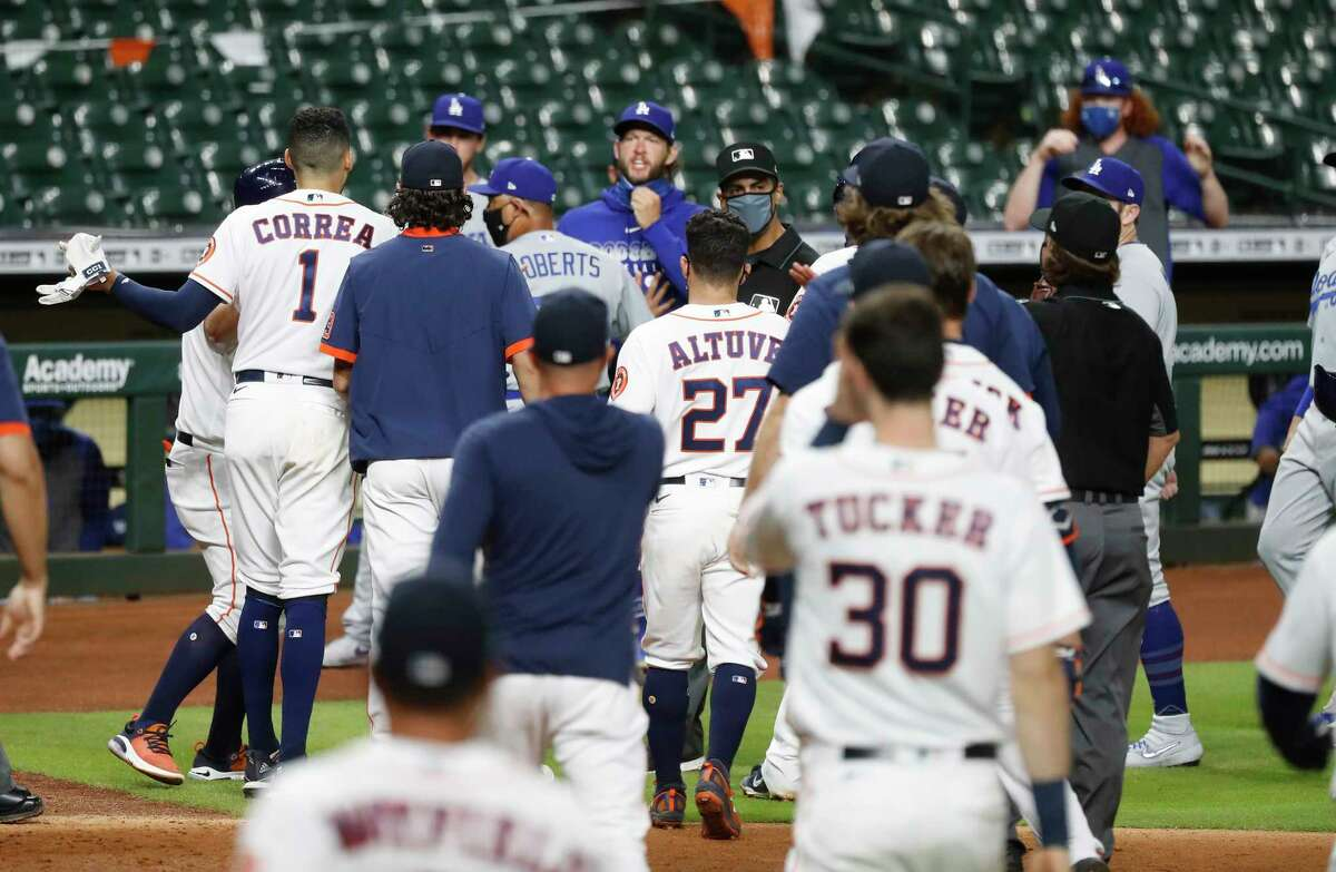 Houston Astros Carlos Correa and Los Angeles Dodgers relief pitcher Joe Kelly confronted each other as both benches and bullpens were cleared during the sixth inning of an MLB baseball game at Minute Maid Park, Tuesday, July 28, 2020, in Houston.
