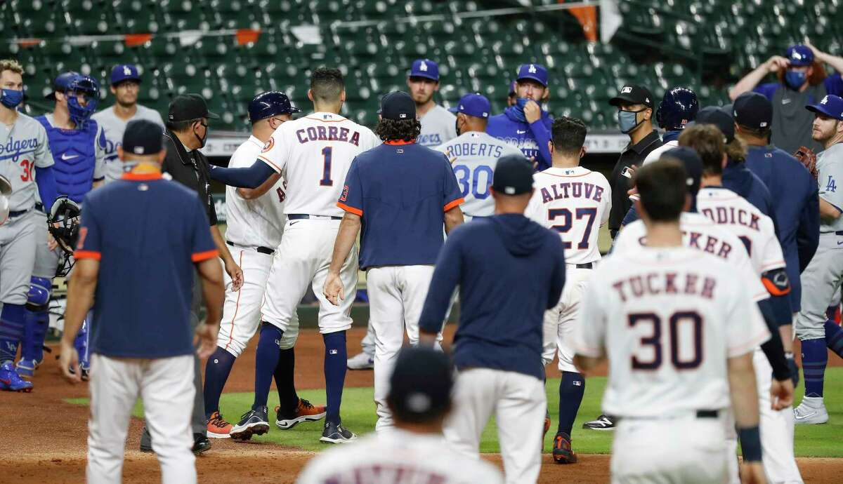 Astros shortstop Carlos Correa (1) and Dodgers reliever Joe Kelly (third from left) confront each other as both benches and bullpens were cleared during the sixth inning Tuesday at Minute Maid Park.