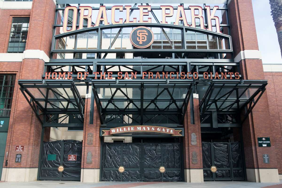 Oracle Parks main gate, where thousands of fans would normally be streaming in to make the first pitch, was tarped over and closed an hour before the San Francisco Giants took on the San Diego Padres in the Giants' home opener at Oracle Park.