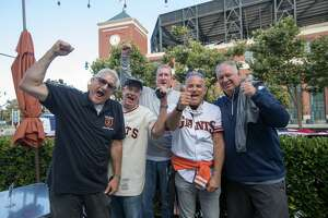 Giants fans (left to right) David Engwall, John Fahey, Steve Ruesink, Mike Fisher and Mike Horner gather at Momo's across from Oracle Park to watch the San Francisco Giants home opener in San Francisco on July 28, 2020.