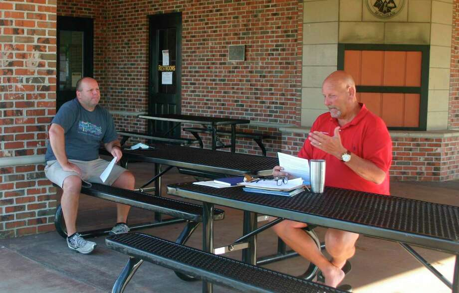 Sen. Curt VanderWall met with constituents during his monthly coffee hour in Reed City on July 20. Among the issues addressed during the meeting was plans for reopening schools in the fall. Trinity Lutheran School Principal Rich Saladin joined the discussion. (Herald Review photo/Cathie Crew)
