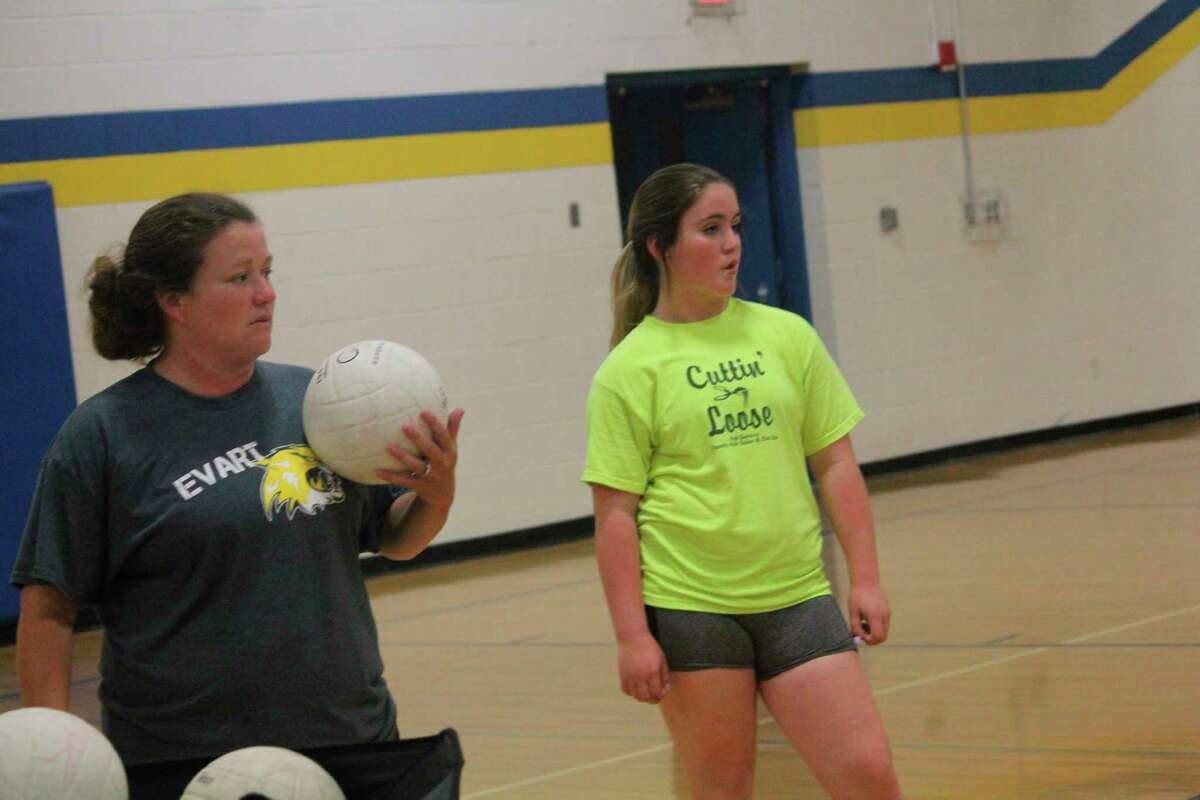 Evart volleyball coach Amanda Brown (left) gets ready to start a summer practice last season at the middle school. (Herald Review file photo)