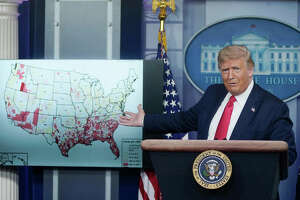 President Donald Trump gestures to a map while speaking during a news conference about his administration's response to the ongoing coronavirus pandemic.