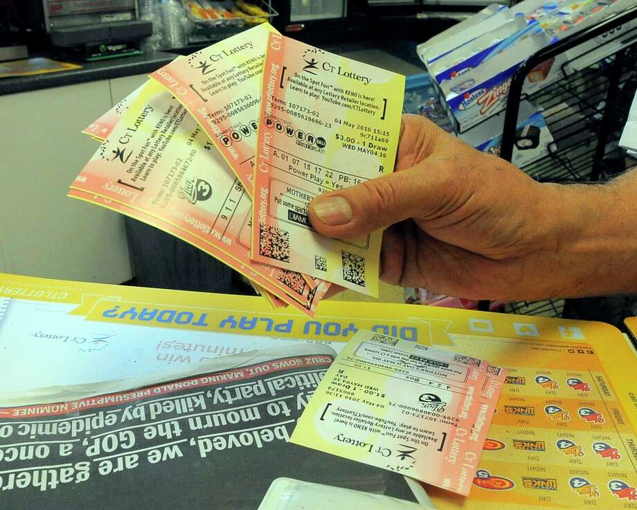 Manuel Mercado, of Stamford, shows his purchased lottery tickets he bought at the Glenbrook News and Variety store on May 4, 2016. Photo: Matthew Brown / Hearst Connecticut Media / Stamford Advocate