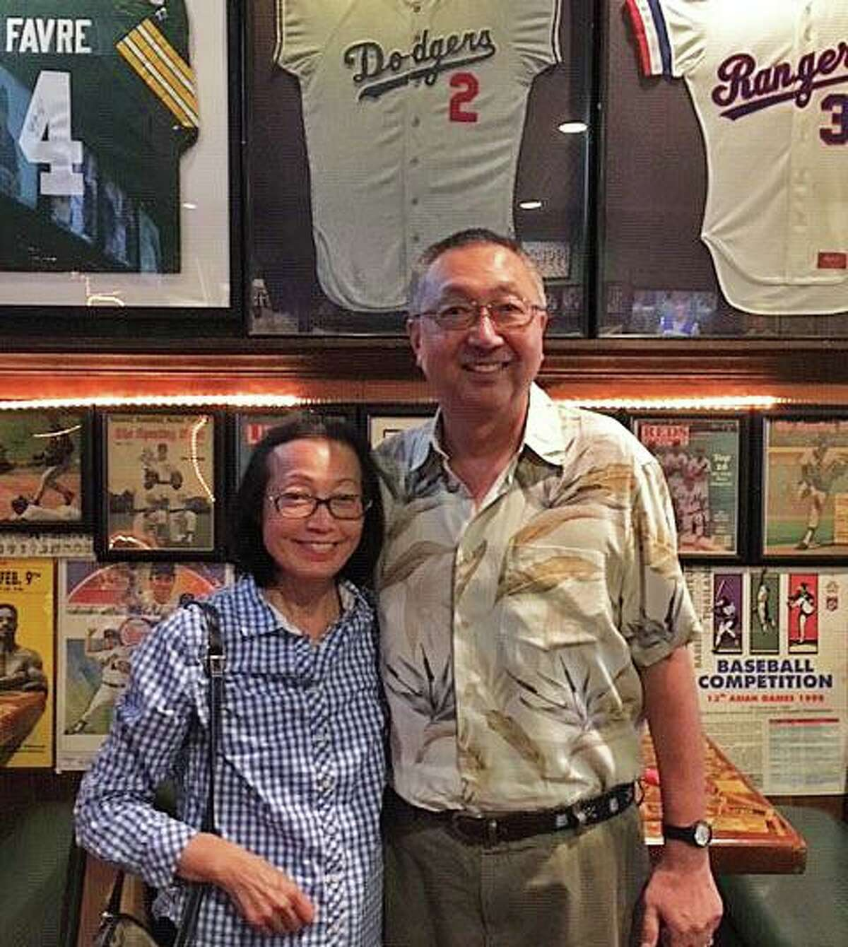Michael Ego, the former director of the University of Connecticut Stamford campus, with his sister, Kimi, at Bobby Valentine's Sports Gallery in Stamford, Connecticut, in 2016.