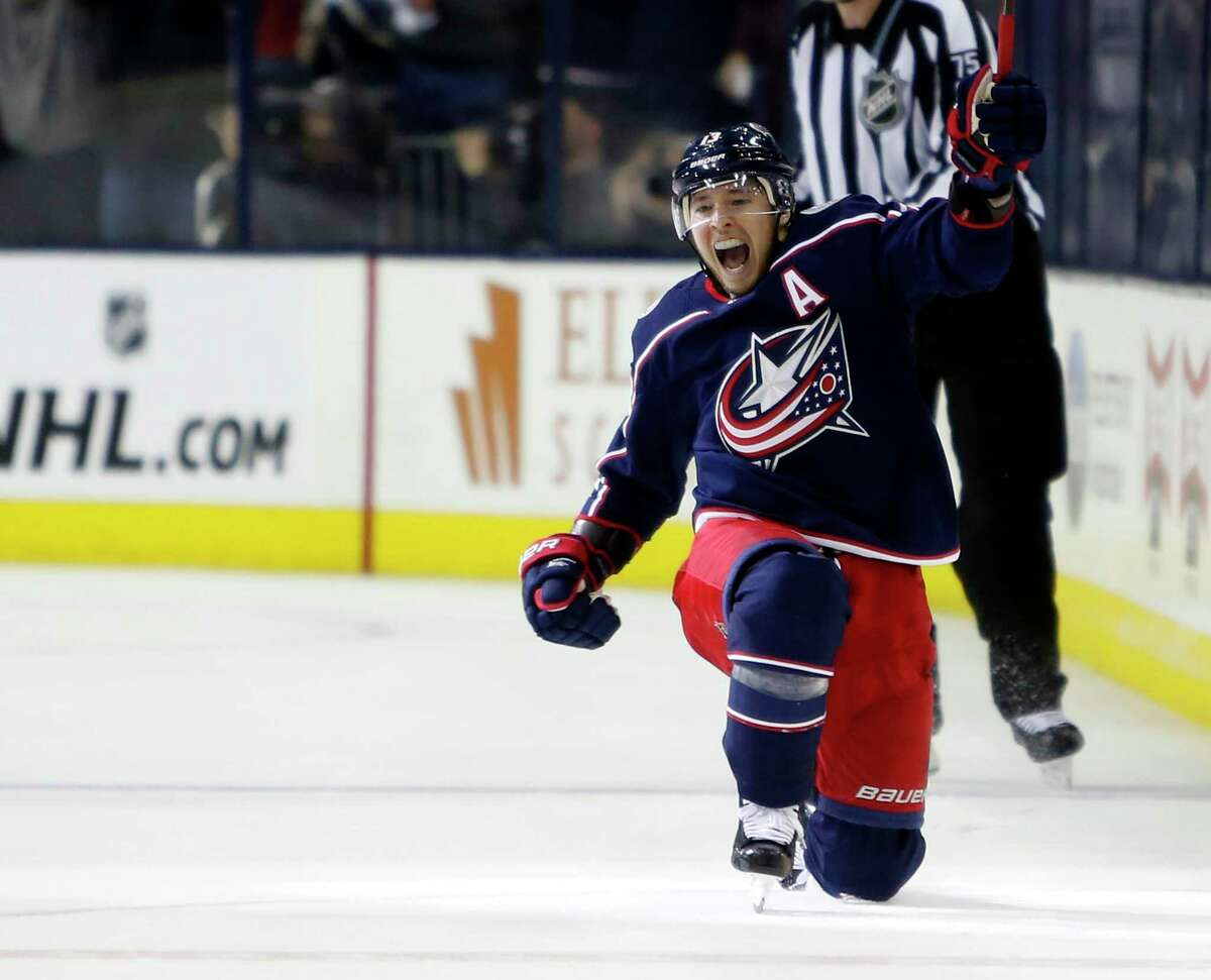 Greenwich's Cam Atkinson of the Columbus Blue Jackets celebrates his goal against the Tampa Bay Lightning during the third period of Game 3 of an NHL hockey first-round playoff series, Sunday, April 14, 2019, in Columbus, Ohio. Atkinson is among the players with Connecticut ties on NHL playoff rosters as the league resumes.