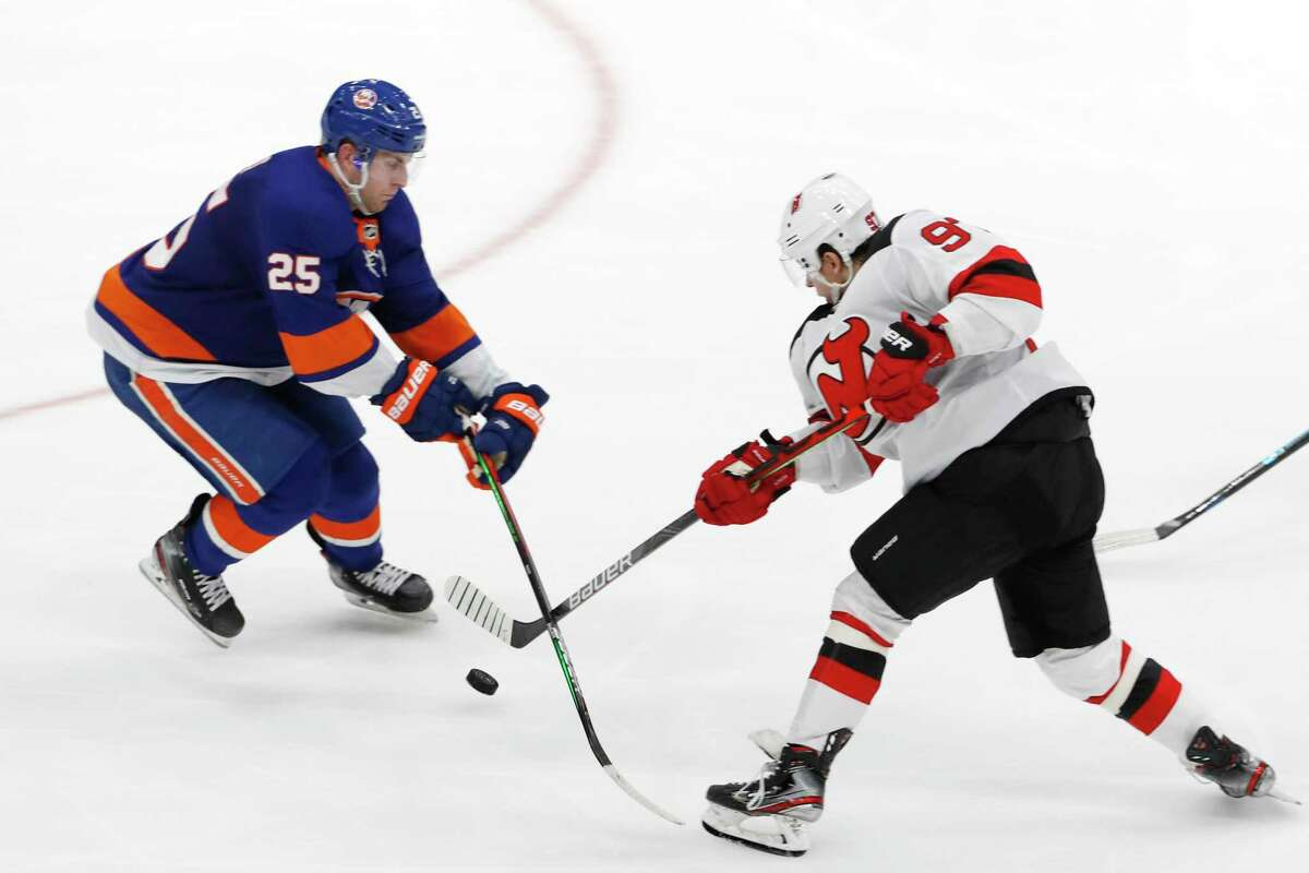 Former Quinnipiac defenseman Devon Toews (25), seen blocking a shot by New Jersey Devils left wing Nikita Gusev (97) during the third period of an NHL hockey game on Jan. 2 has played in 68 games for the New York Islanders during the 2019-20 season.