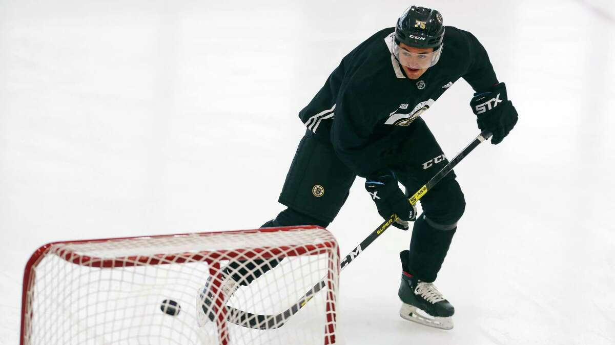 Boston Bruins defenseman Connor Clifton, a former Quinnipiac star, shoots on a training net at the NHL hockey team's camp on Wednesday, July 15, 2020, in Boston. Connor Clifton - Quinnipiac University Boston Bruins (D)