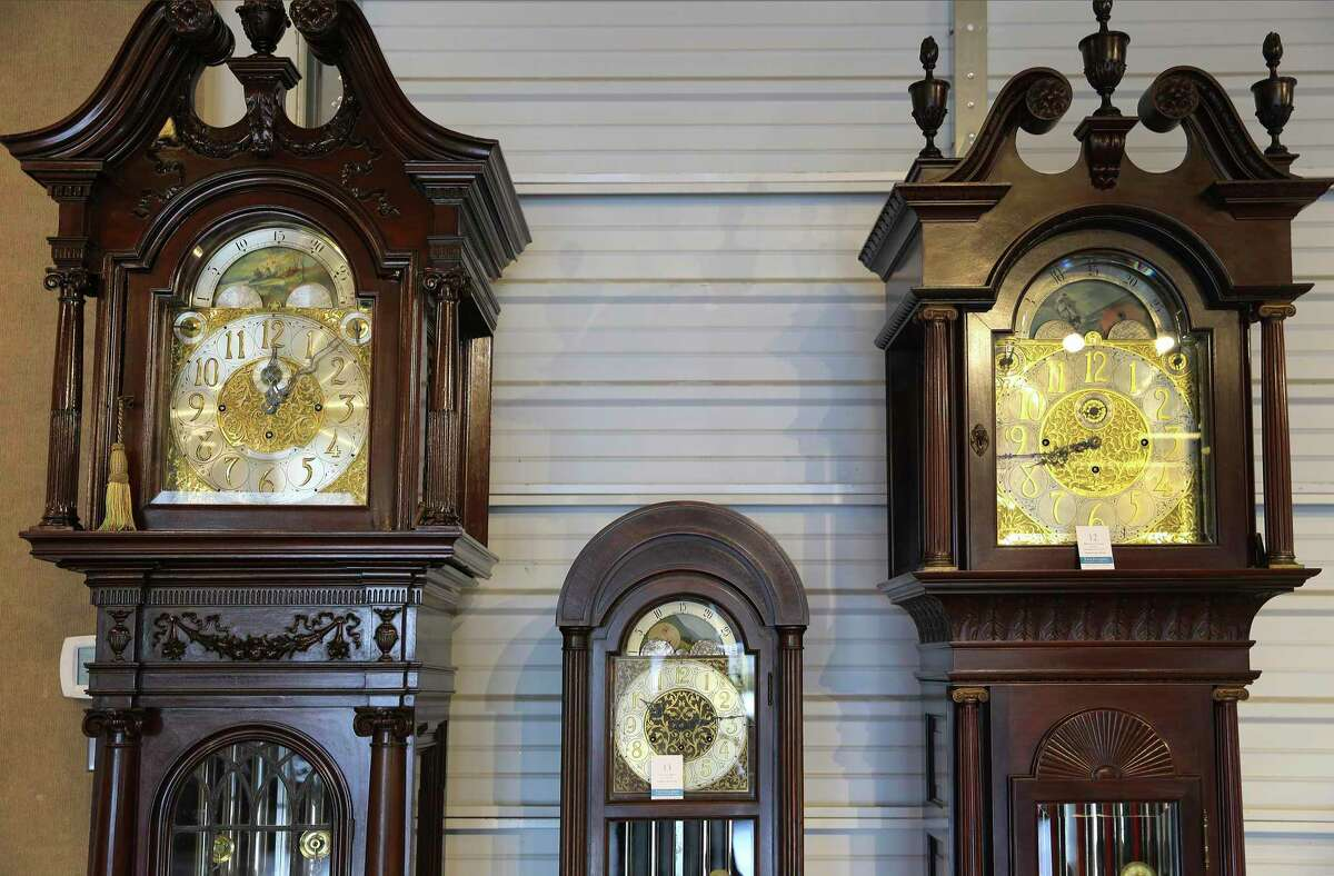 A row of grandfather clocks are some of the items featured at Vogt Auction Galleries. Traditional items such as grandfather clocks are coming back in fashion, Vogt says.