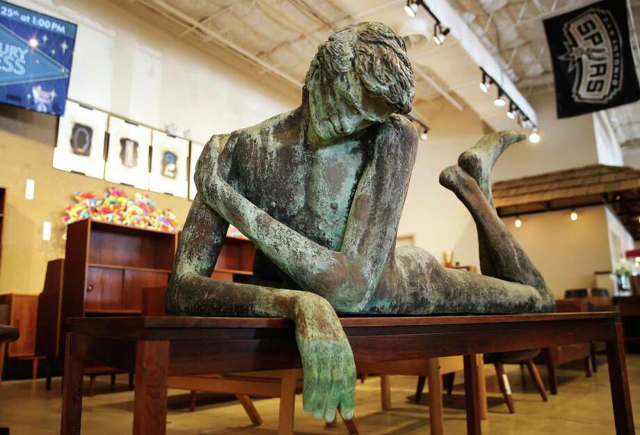 LEFT: A life-sized statue at Vogt Auction Galleries. The internet has allowed the business to expand into fine art, jewelry and expensive watches, Rob Voght says. Photo: Kin Man Hui /Staff Photographer / **MANDATORY CREDIT FOR PHOTOGRAPHER AND SAN ANTONIO EXPRESS-NEWS/NO SALES/MAGS OUT/ TV OUT