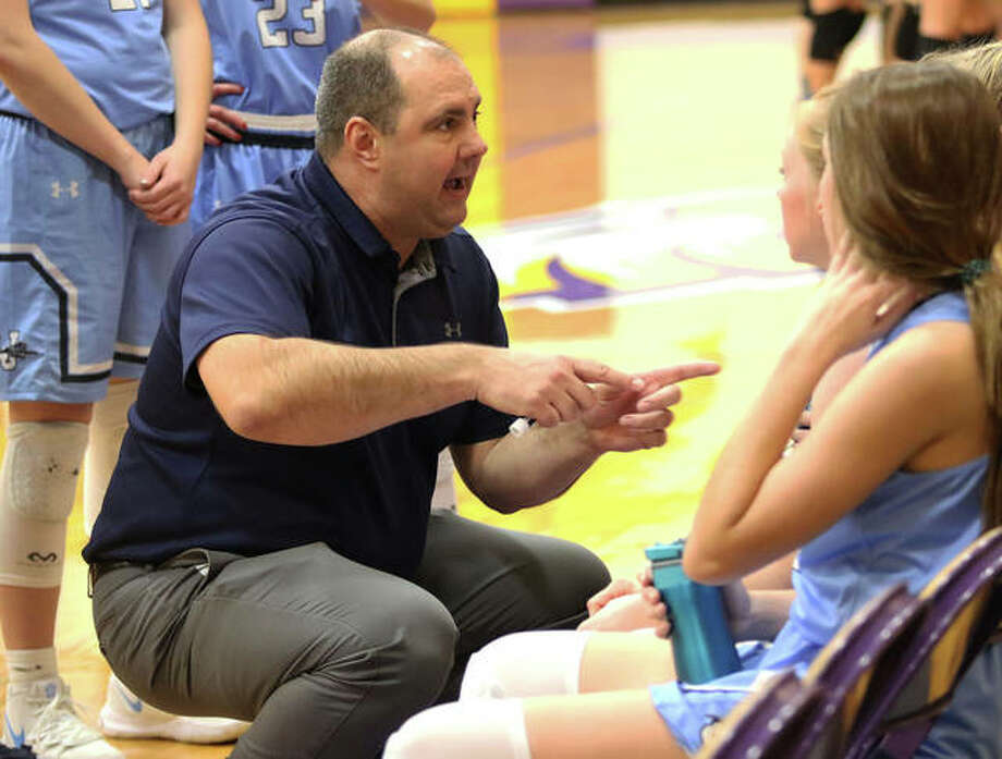 Jersey coach Kevin Strebel talks to his team during a timeout in a game last season at Bethalto. Strebel is the 2020 Telegraph Large-Schools Girls Basketball Coach of the Year. Photo: Greg Shashack / The Telegraph