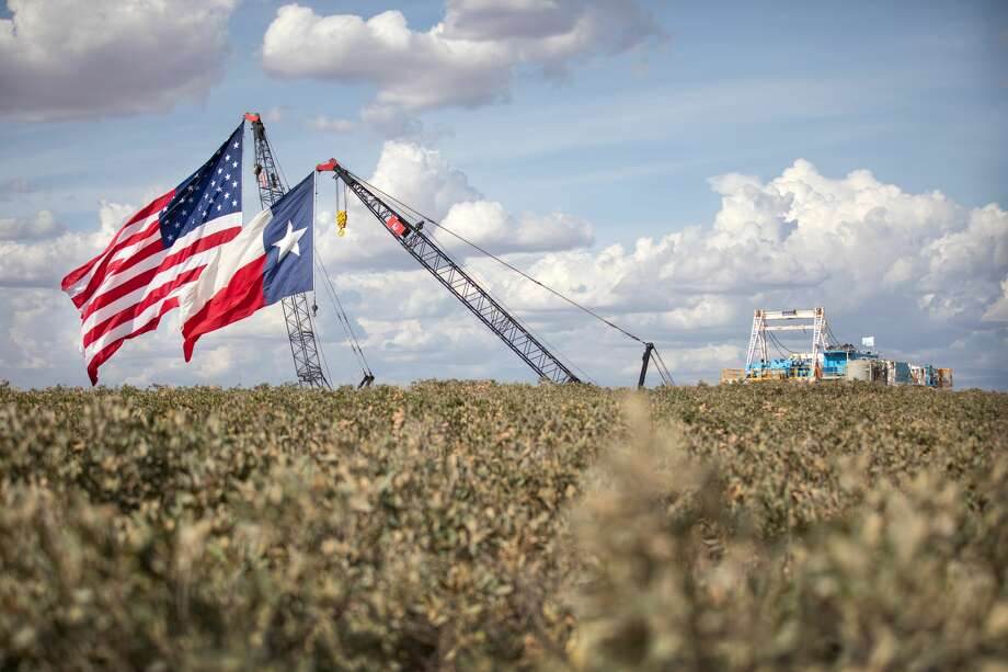 MIDLAND, TX - JULY 28: The American and Texas flags are raised at the site of a Double Eagle Energy rig on July 28, 2020 in Midland, Texas. President Donald Trump is making his 16th visit to the state, where he will tour a rig owned by Double Eagle Energy and deliver remarks. (Photo by Montinique Monroe/Getty Images) Photo: Montinique Monroe/Getty Images / 2020 Getty Images