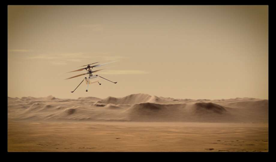 An artist's concept of NASA's Ingenuity Mars Helicopter flying through the Red Planet's skies. Photo: Courtesy Of NASA