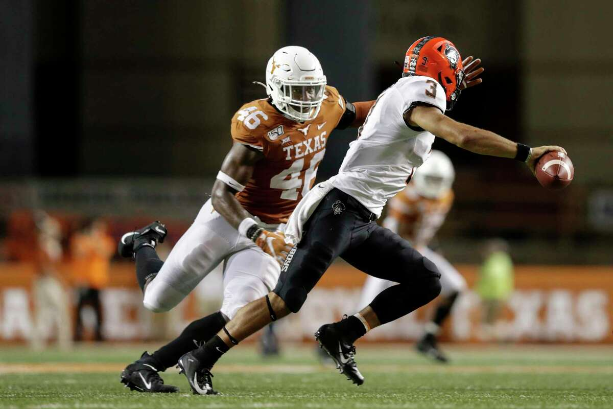 AUSTIN, TX - SEPTEMBER 21: Spencer Sanders #3 of the Oklahoma State Cowboys rolls out to pass under pressure by Joseph Ossai #46 of the Texas Longhorns in the fourth quarter at Darrell K Royal-Texas Memorial Stadium on September 21, 2019 in Austin, Texas. (Photo by Tim Warner/Getty Images)