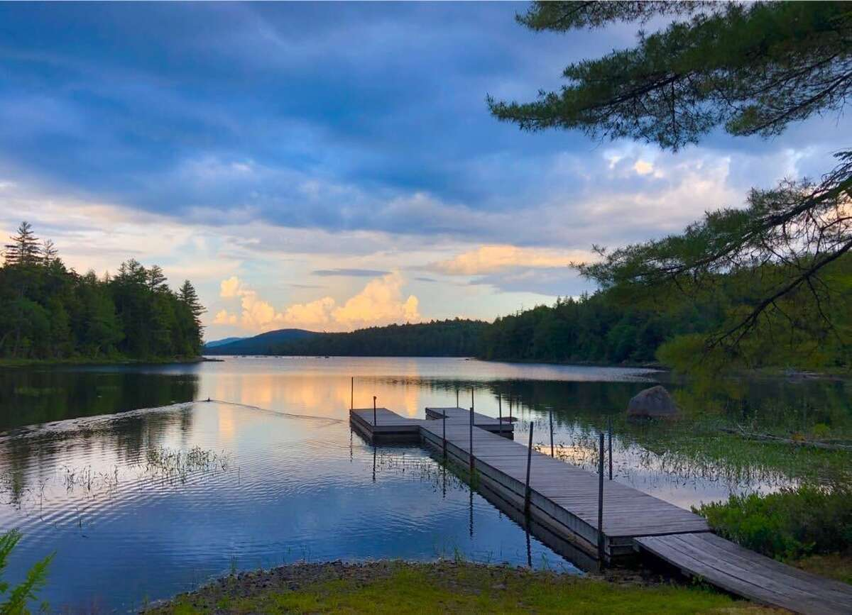 The Adirondack estate owned by the Whitney family is on the market for $180 million. John Hendrickson, widower of Marylou Whitney, tells the Wall Street Journal that he plans to sell the 36,000-acre estate in Long Lake - including the family's great camp Deerlands- that has been in the Whitney family since the 1890s.