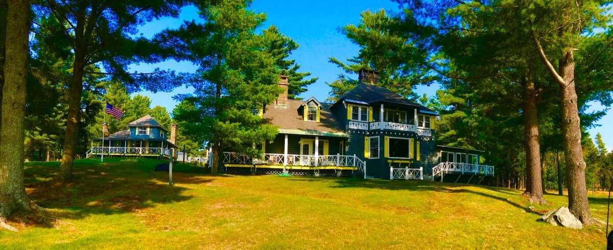 The Adirondack estate owned by the Whitney family is on the market for $180 million. John Hendrickson, widower of Marylou Whitney, tells the Wall Street Journal that he plans to sell the 36,000-acre estate in Long Lake - including the family's great camp Deerlands, above.