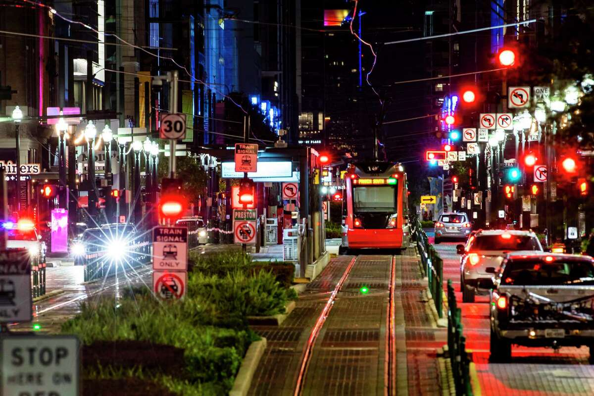 A Metropolitan Transit Authority light rail train travels along Main Street on July 28, 2020, in downtown Houston. City and downtown officials, spurred by some bar owners and restaurateurs, are working on possible plans to use Main Street for outdoor dining.
