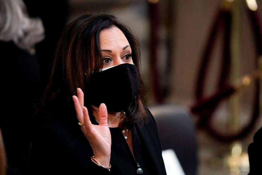 Sen. Kamala Harris, D-California, talks to colleagues prior to the start of the ceremony preceding the lying in state of US Representative from Georgia John Lewis in the Rotunda of the US Capitol in Washington, DC, on July 27, 2020. Photo: J. Scott Applewhite, POOL/AFP Via Getty Images