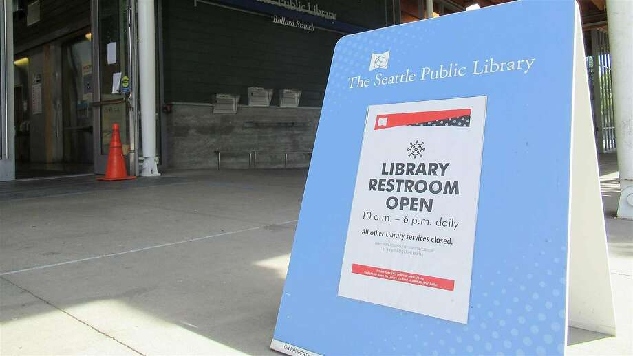 The Ballard branch of the Seattle Public Library has reopened its restrooms to the public, one of the few places in the city where facitlites remain available. (Alex Brown/Pew Charitable Trusts/TNS) Photo: Alex Brown, TNS