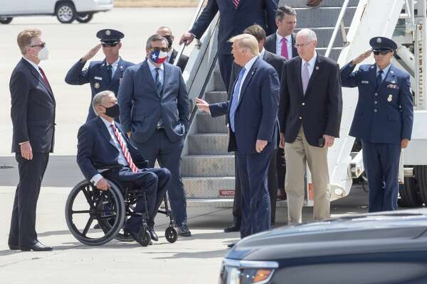 President Trump arrives on Air Force One with Sen Mike Conaway, Sen Ted Cruz and is greeted by Governor Abbott and Lt. Governor Dan Patrick and others 07/29/2020 at the Midland International Air & Space Port. Tim Fischer/Reporter-Telegram