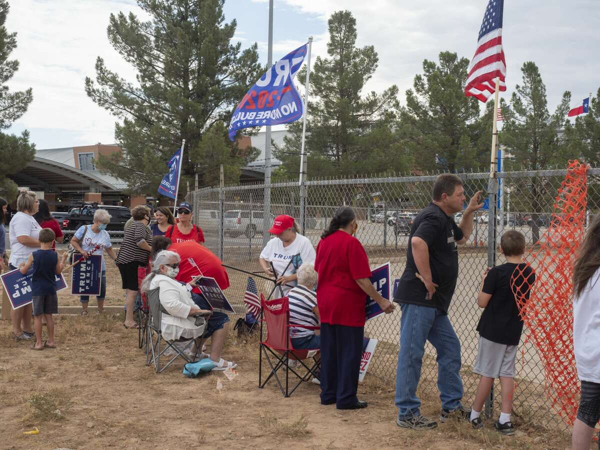 President Trump supporters put up signs and flags 07/29/2020 outside the airport tarmac before the arrival of Air Force One. Tim Fischer/Reporter-Telegram