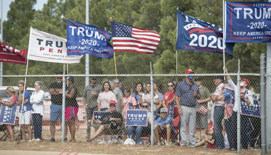President Trump supporters put up signs and flags 07/29/2020 outside the airport tarmac before the arrival of Air Force One. Tim Fischer/Reporter-Telegram Photo: Tim Fischer/Midland Reporter-Telegram